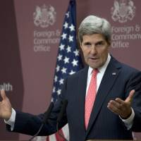 Peace push: U.S. Secretary of State John Kerry speaks about the war in Syrian at the British Foreign Office in London on Tuesday | AP