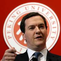 Red-carpet treatment: British finance minister George Osborne delivers a speech at Peking University in Beijing on Monday. Britain is to   AFP-JIJI |  AFP-JIJI
