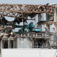 Nuclear husk: The destroyed No. 4 reactor building at Tokyo Electric Power Co.'s Fukushima No.1 nuclear power plant is seen in May 2012.  | BLOOMBERG