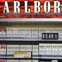 Australia's 'plain packaging' stubs out cigarette branding, prompts backlash