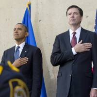 Hard landing: U.S. President Barack Obama and new FBI Director James Comey stand for the National Anthem during the latter's inauguration ceremony at FBI headquarters in Washington on Monday | AFP-JIJI