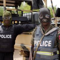 Masked assault: Nigerian police in Borno state prepare for a June patrol in the city of Maiduguri, where the Islamist militant group Boko Haram was founded more than a decade ago | AFP-JIJI