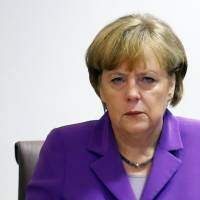 Evil eye: German Chancellor Angela Merkel attends a European Union heads of state summit meeting in Brussels on Friday | AFP-JIJI