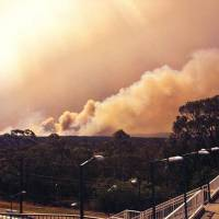 Australia wildfires destroy homes, darken Sydney skies
