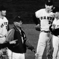 Leader of a dynasty: Former Yomiuri Giants skipper Tetsuharu Kawakami, talking to his players in 1967, led the storied franchise to 11 Japan Series titles. He retired as manager in 1974 | KYODO