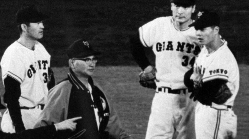 Leader of a dynasty: Former Yomiuri Giants skipper Tetsuharu Kawakami, talking to his players in 1967, led the storied franchise to 11 Japan Series titles. He retired as manager in 1974