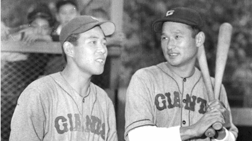 Legend of the game: Tetsuharu Kawakami (right), standing next to ex-Giants teammate Noboru Aota, captured five batting titles during his illustrious 18-year playing career, which ended in 1958. He became the first player in NPB history to reach 2,000 hits and nabbed Central League MVP honors three times