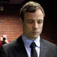 'Blade Gunner': Double-amputee Olympian Oscar Pistorius appears at the magistrates court Aug. 19 to be charged with murder and illegal possession of ammunition for the shooting death of his girlfriend on Valentine's Day in Pretoria. Prosecutors have been given permission by South Africa's National Director of Public Prosecutions to add two firearms charges to the indictment | AP