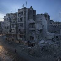 Uncivil war: Night falls on a rebel-controlled area, including a destroyed hospital, in Aleppo, Syria, on Nov. 29, 2012 | AP