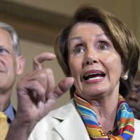 No backing down: U.S. House Minority Leader Rep. Nancy Pelosi is accompanied by Rep. Steve Israel (left) and House Assistant Minority Leader James Clyburn at a news conference on the looming government shutdown in Washington on Monday. | AP