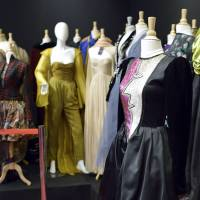 An Yves Saint Laurent haute couture dress named 'Picasso' belonging to former French model Danielle Luquet De Saint Germain is displayed with 313 other fashion items to be auctioned off on Monday in Paris. | AFP PHOTO