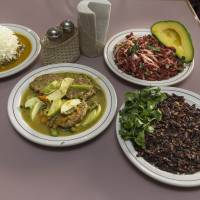 Today's specials: Plates of (from left) ant eggs with chrysanthemum petals, pancakes of mosquito eggs with cactus leaves and pumpkin flowers, small crayfish with avocado and onion, and grasshoppers flambeed in mezcal are displayed at the Don Chon restaurant in a blue-collar section of Mexico City on Aug. 18. | AFP-JIJI