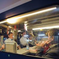 Red-eye run: Commuters sit in a high-speed train for Paris at dawn Sept. 6 in Le Mans. | AFP-JIJI