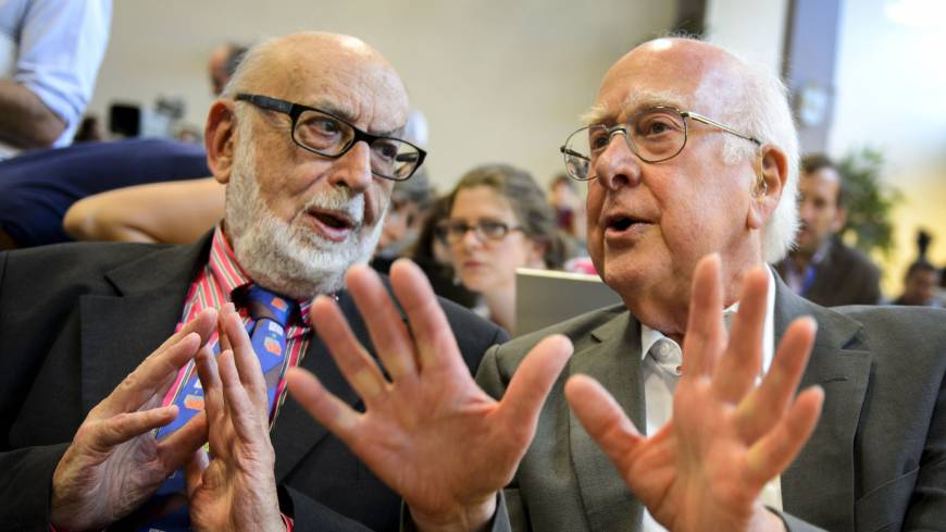 Recognized: British physicist Peter Higgs (right) and Belgian colleague Francois Englert exchange views during a news conference in Meyrin, near Geneva, in July 2012.