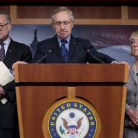 Last hope: Senate Majority Leader Sen. Harry Reid gives a news conference with Sen. Chuck Schumer (left) and Sen. Patty Murray on Capitol Hill on Saturday. | AP