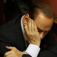 Waiting: Ex-Prime Minister Silvio Berlusconi sits in the Senate in Rome on Oct. 2. | AP