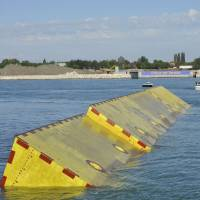 Floating a plan: Movable underwater panels emerge from the lagoon as the first test of Venice's flood barriers is carried out on Saturday. | AP