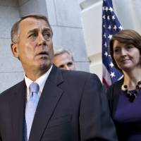 Eleventh hour brainstorming: Speaker of the House John Boehner speaks to reporters after a Republican strategy session in the U.S. Capitol in Washington on Tuesday. | AP