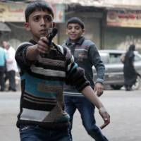 Dangerous games: A Syrian boy plays with a toy gun in the Bustan al-Qasr neighborhood of Aleppo on Tuesday. | AFP-JIJI