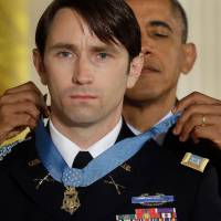Overdue: President Barack Obama awards the Medal of Honor to former U.S. Army Capt. William Swenson during a ceremony in the East Room of the White House on Tuesday. | AP