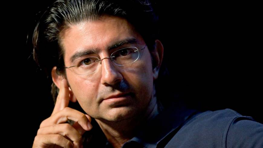 Reporting for duty: Pierre Omidyar, the founder of eBay, listens to a question at the eBay Developer's Conference in Boston in June 2007. Omidyar announced last week a $250 million investment in the most hotly awaited news startup in years.