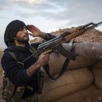 Syrian Kurds route jihadists at major border crossing with Iraq