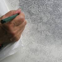 A close-up of Hiroyuki Doi at work on a new drawing in his studio in Tokyo recently. | EDWARD M. GOMEZ