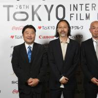 Vote of confidence: Jacob Wong (center) with fellow Asian Future jury members Koichi Nojima and Shinji Aoyama at this year's Tokyo International Film Festival. | © 2013 TIFF