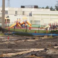 Tainted land: Barrels containing the ingredients of military defoliants were unearthed in June on what used to be a soccer pitch next to two U.S. Department of Defense schools in Okinawa City. | JON MITCHELL