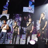 Rock you: One Direction (left-right: Liam Payne, Louis Tomlinson, Zayn Malik, Harry Styles and Niall Horan) performs for fans at Chiba's Makuhari Messe convention center on Saturday. | YOSHIKA HORITA