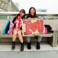 Looking for love: One Direction fans, also known as 'directioners,' showed up to the band's Chiba show on Sunday sporting red happi coats. | JAMES HADFIELD