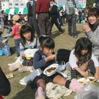 Spice of life: Families enjoy various curries at the Tsuchiura Curry Festival.