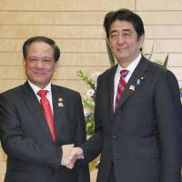 Connectivity: ASEAN Secretary-General Le Luong Minh is greeted by Prime Minister Shinzo Abe ahead of their meeting Tuesday in Tokyo. Minh is on a four-day visit to Japan to prepare for a Dec. 13-15 ASEAN special summit to mark 40 years of diplomatic ties. | KYODO