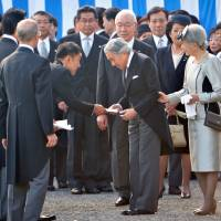 Controversial gambit: Upper House lawmaker Taro Yamamoto hands a letter to Emperor Akihito (center) during the autumn garden party at the Akasaka Palace Imperial Garden on Thursday. | POOL