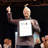 How sweet it is: Hironobu Tsujiguchi gives the thumbs-up sign after receiving the highest award at the Salon du Chocolat global chocolate fair in Paris on Thursday. | KYODO