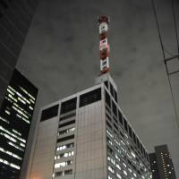 Watts up: It's business as usual at Tokyo Electric Power Co. headquarters Thursday night. | AFP-JIJI