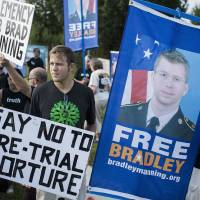 Long stretch: Supporters of Chelsea (formerly Bradley) Manning, who was sentenced to 35 years in prison for leaking tons of classified documents to WikiLeaks, wait to hear her sentence outside Fort George G. Meade in Maryland in August. | GETTY IMAGES/KYODO