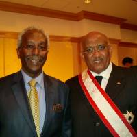 Former Djiboutian Prime Minister Dileita Mohamed Dileita (right), who was awarded the Grand Cordon of the Order of the Rising Sun, attends a reception on Nov. 6 in Tokyo organized by Djiboutian Ambassador Ahmed Araita Ali. | CHIHO IUCHI