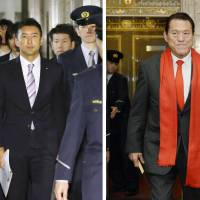 Transgressors: Upper House lawmakers Taro Yamamoto (left) and Antonio Inoki enter the Diet on Friday. The chamber's Steering Committee banned Yamamoto from attending Imperial family events and Inoki faces punishment for visiting North Korea without approval. | KYODO
