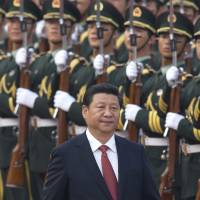 Power play: Chinese President Xi Jinping attends a ceremony at the Great Hall of the People in Beijing on Wednesday | AP