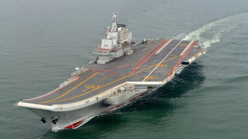 Ramping up: The Chinese aircraft carrier Liaoning, seen in May 2012, left Qingdao port Tuesday for the South China Sea.
