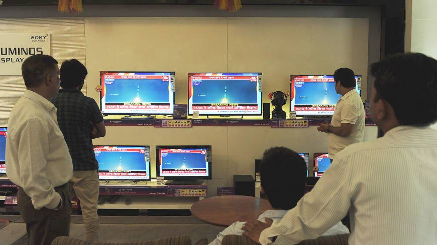 Up, up and away: A group of Indians watch a live telecast of the country's Mars Orbiter Mission launch in New Delhi on Tuesday