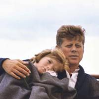 Early years: Caroline Kennedy and her father, President John F. Kennedy, sit on a yacht on Hyannis Sound in Massachusetts | CECIL STOUGHTON/BLOOMBERG