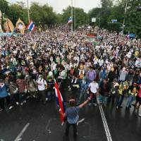 Thai protesters force way into government ministries
