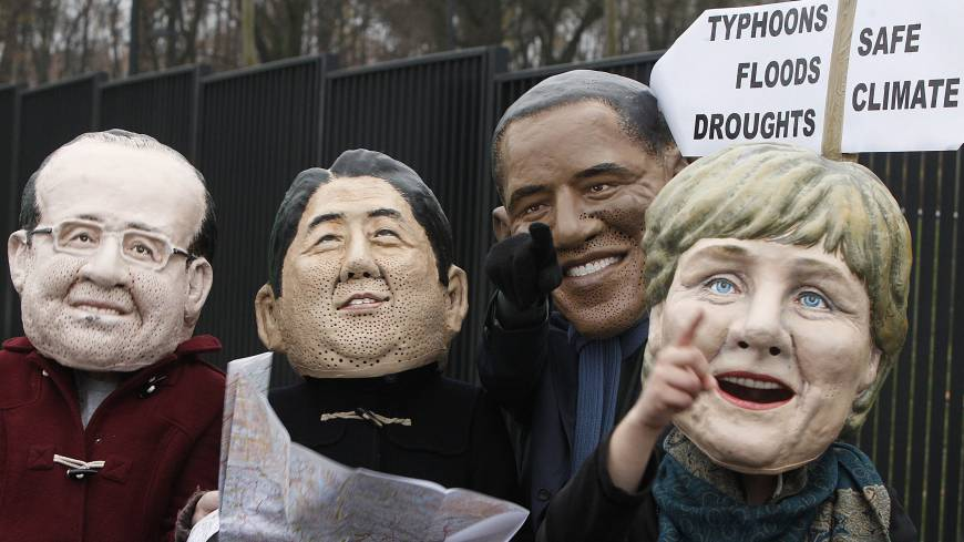 The usual suspects: Activists spoof world leaders (from left) French President Francois Hollande, Prime Minister Shinzo Abe, U.S. President Barack Obama and German Chancellor Angela Merkel outside the U.N. climate change conference in Warsaw on Friday.
