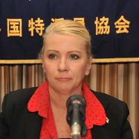With tears in her eyes, Catherine Fisher, the victim of a 2002 rape by an American serviceman near the U.S. Navy base in Yokosuka, pauses during a news conference Thursday at the Foreign Correspondents' Club of Japan in Tokyo. | COURTESY OF FCCJ