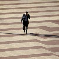 Crossing the line: A man talks on his cellphone in Madrid on Tuesday. According to a report Saturday, Spain, Germany, France and Sweden carry out mass surveillance of online and phone traffic   AP