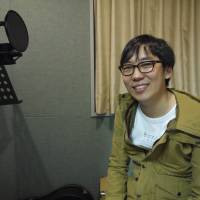 Aiming high: Inhyeok Yeo sits in a recording studio in Tokyo. The 26-year-old singer has set his sights on winning a Grammy Award. | TOMOKO OTAKE