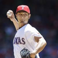Hot stuff: Texas' Yu Darvish was second in voting for the AL Cy Young Award, leading a strong showing from Japanese pitchers. | AP