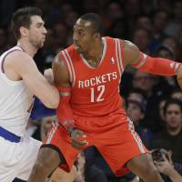 Muscle on muscle: Houston's Dwight Howard backs down New York's Andrea Bargnani in the first half on Thursday night | AP